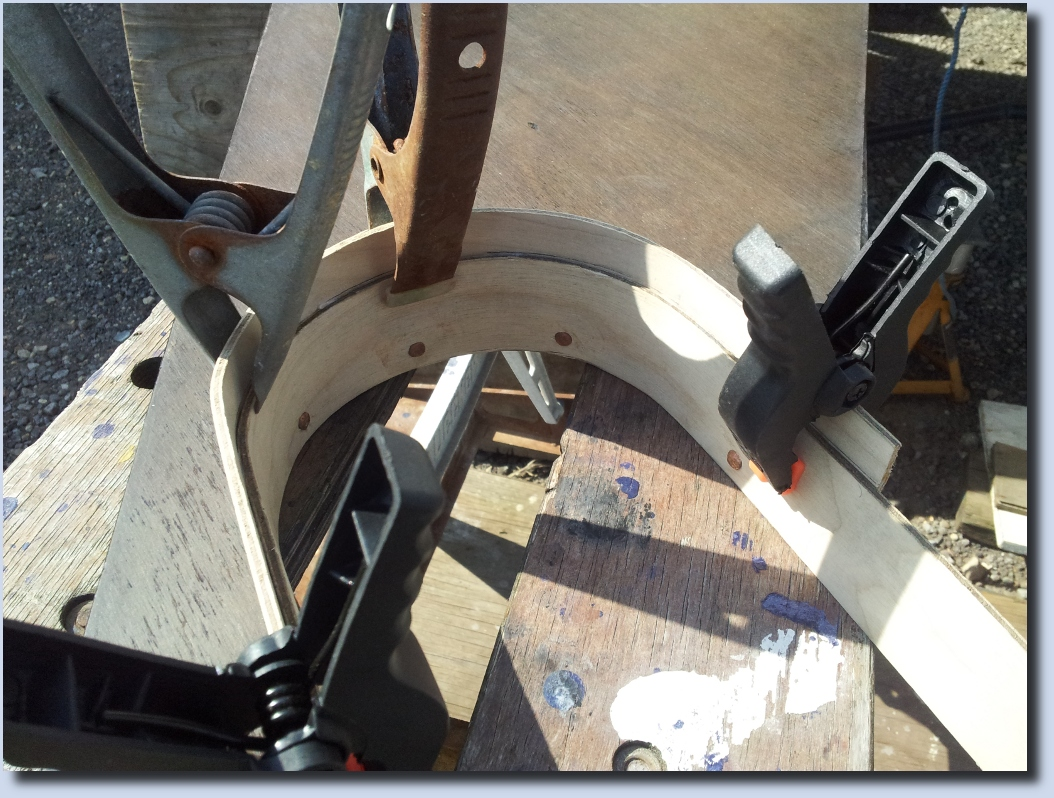 Image of Clamping the steamed Plywood to shape
